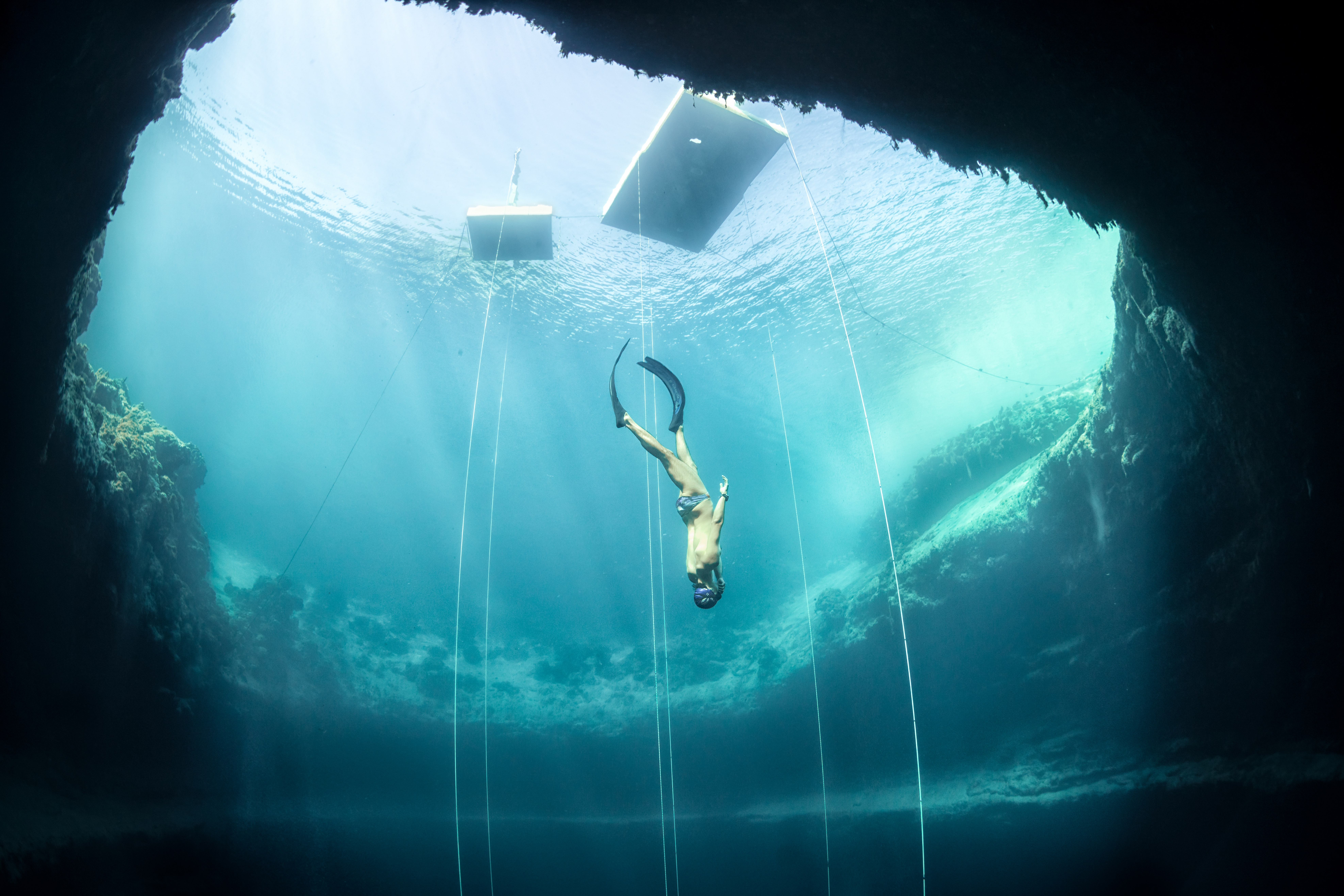 Freediving into a sea abyss over 200 metres deep
